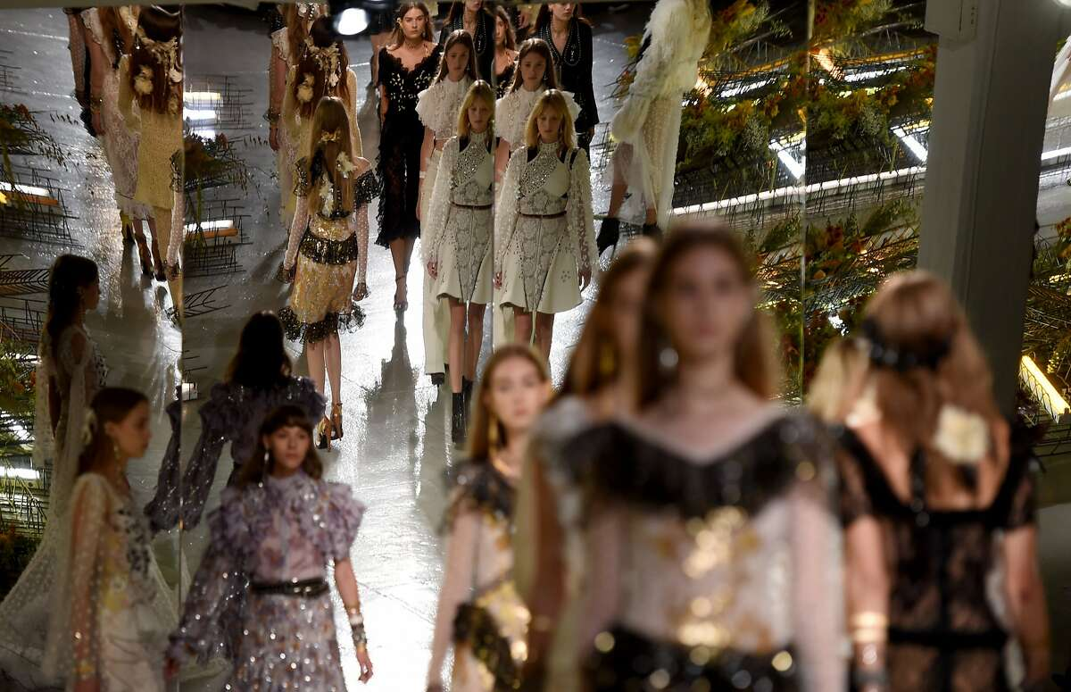 Models display fashions during the Rodarte Spring-Summer 2017 Runway show at New York Fashion Week in New York on September 13, 2016. / AFP PHOTO / TIMOTHY A. CLARYTIMOTHY A. CLARY/AFP/Getty Images