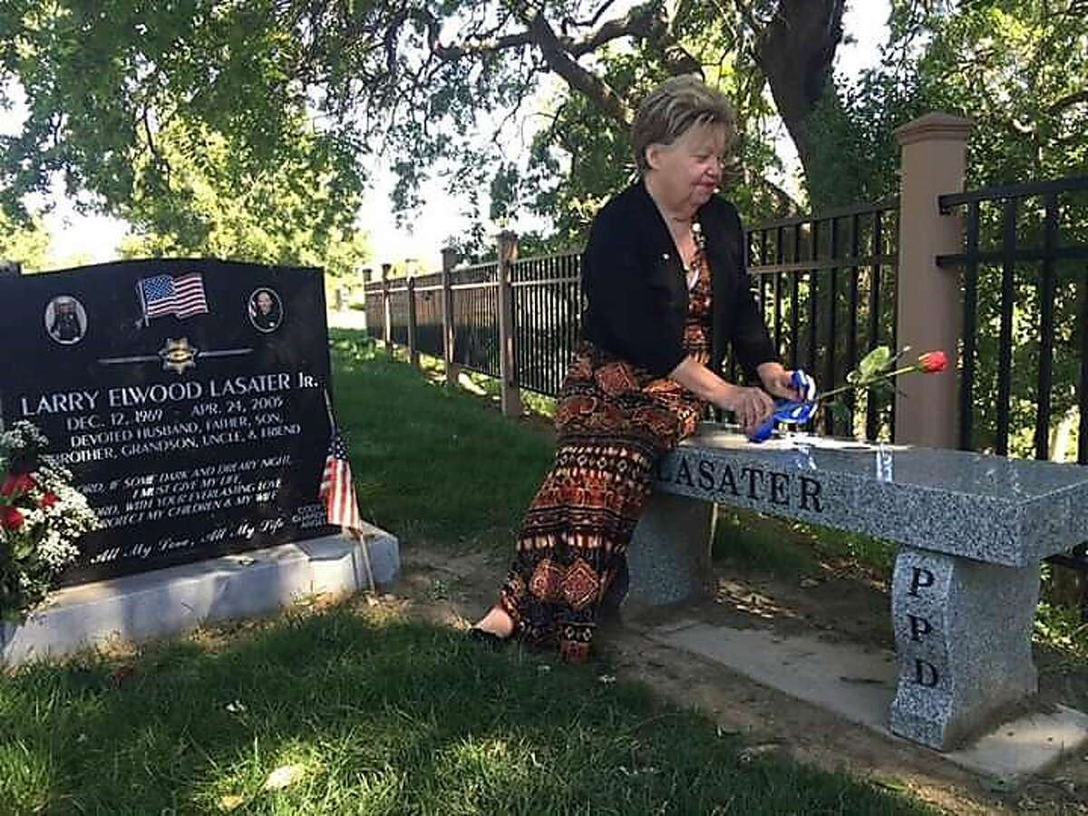 Phyllis Loya at the grave of�her son, Larry Lasater,�a Pittsburg police officer who was shot to death in 2005.