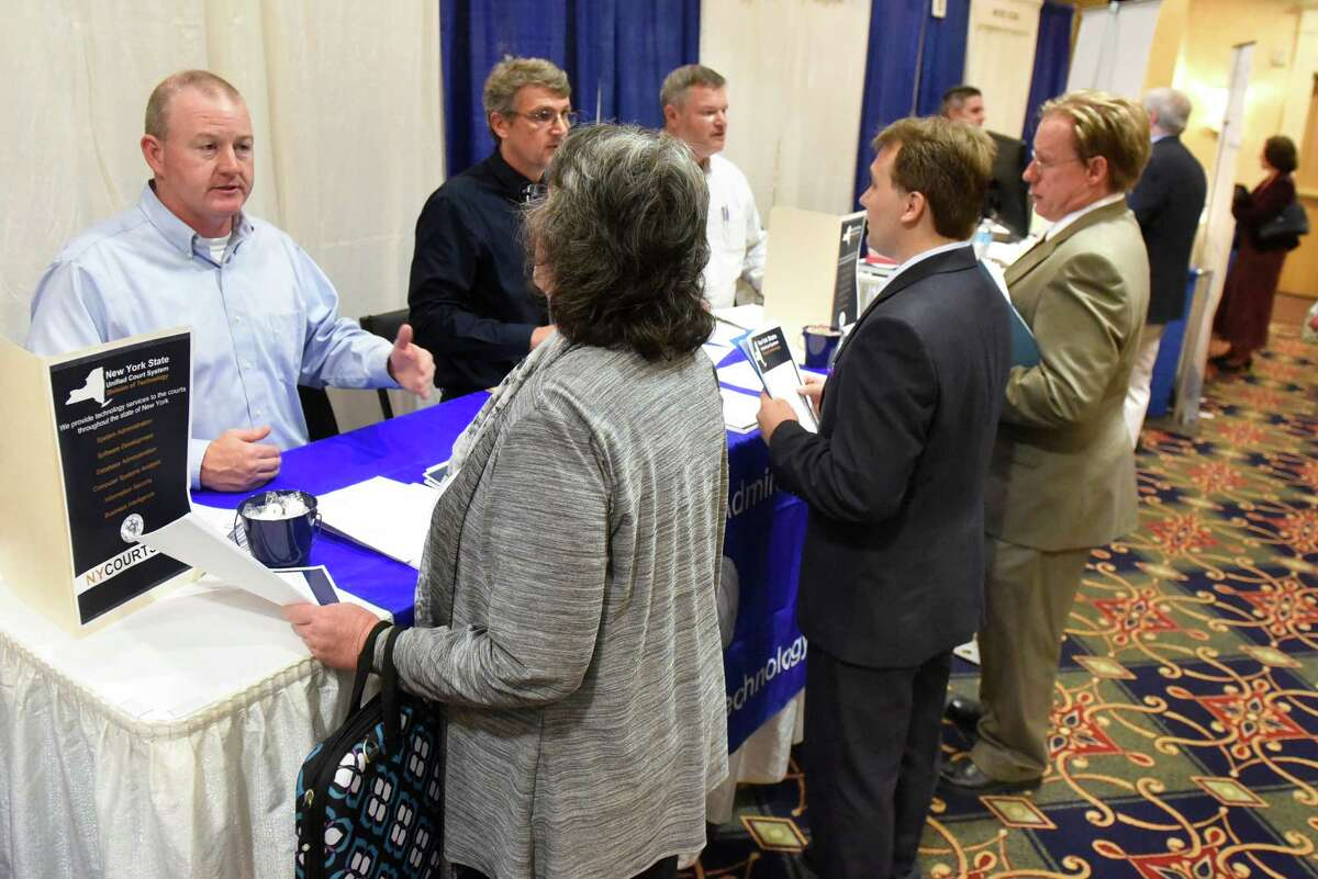 Job seekers talk with members of the New York State Unified Court Systems Division of Technology during an annual technology and manufacturing job fair on Tuesday, Sept. 13, 2016, at Albany Marriott hotel in Colonie, N.Y. (Cindy Schultz / Times Union)