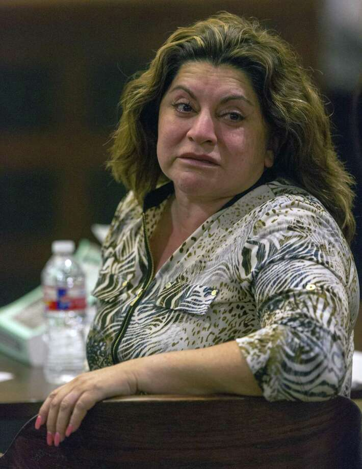 Frances Hall looks to her family members in the gallery Thursday, Sept. 13, 2016 moments after the jury left the courtroom to begin deliberations in the punishment phase of Hall's murder trial. Hall was convicted last week of killing her husband, trucking tycoon Bill Hall, in 2013 by running his motorcycle off the road with her Cadillac SUV. Photo: William Luther,  Staff / San Antonio Express-News / © 2016 San Antonio Express-News