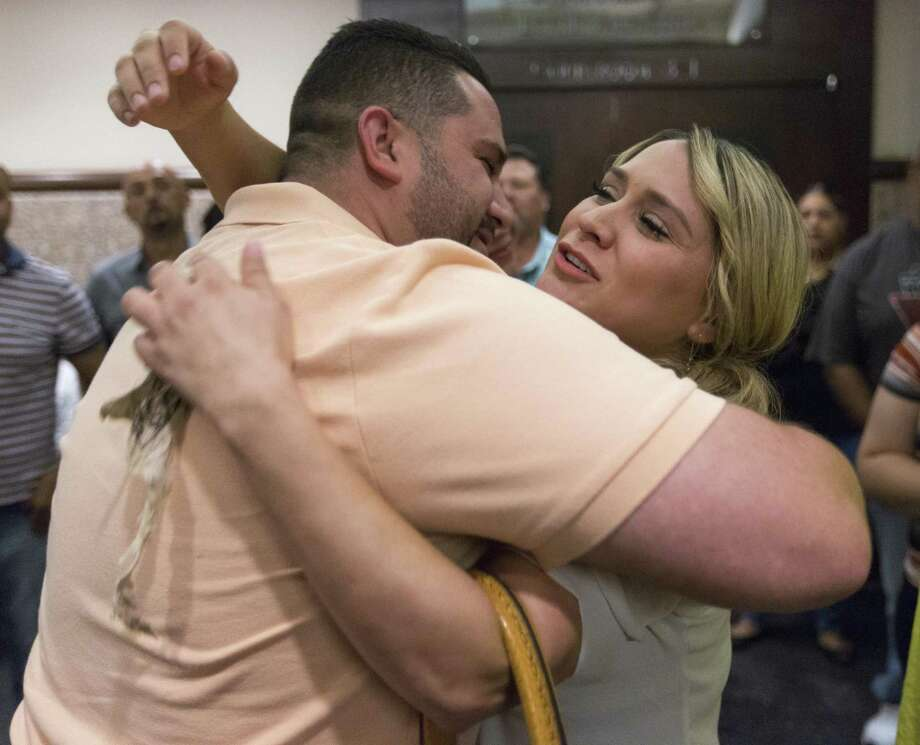 Justin Hall, left, and sister Dominique Hall hug in this September photo after their mother Frances Hall was sentenced to two years in prison for the 2013 murder of her husband, trucking tycoon Bill Hall Jr. Justin now accuses his sister of improperly transferring assets belonging to Bill Hall Jr. trucking to her own trucking businesses. Photo: William Luther /San Antonio Express-News / © 2016 San Antonio Express-News
