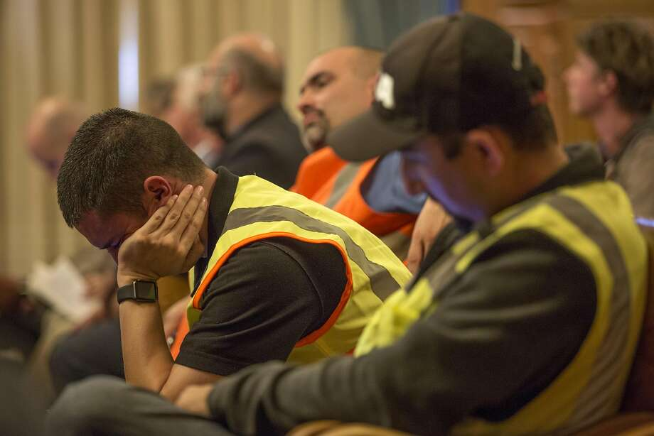 Members of the group Carpenters in Action attend the Board of Supervisors meeting in a show of support of the project. Photo: Santiago Mejia, Special To The Chronicle