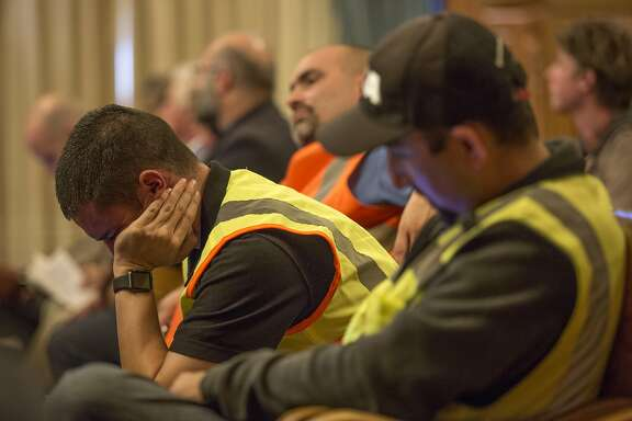 Carpenters In Action members listen in to community members speak against the Beast on Bryant project, during a Board of Supervisors meeting, on Tuesday, Sept. 13, 2016 in San Francisco, Calif.