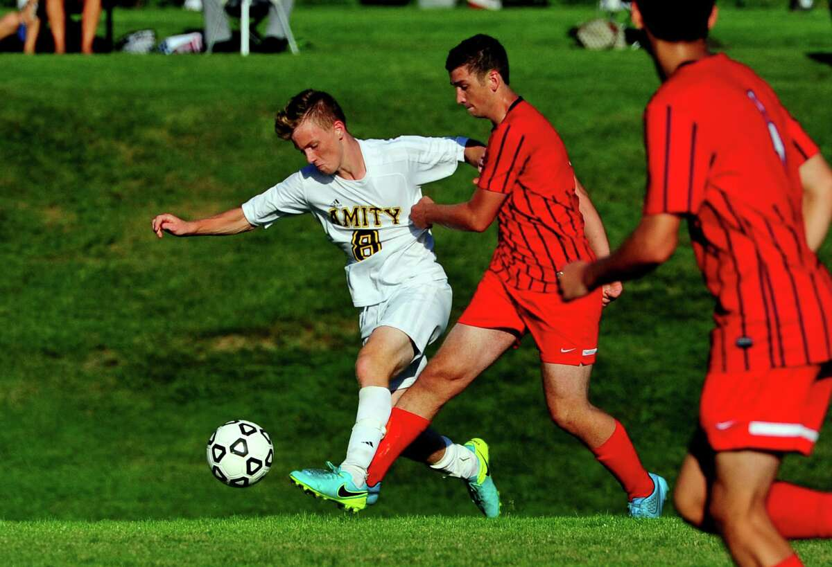 Amity's Thomas Kanter cuts off Foran's Dylan Attolino for control of the ball during boys soccer action in Woodbridge, Conn., on Tuesday Sept. 13, 2016.