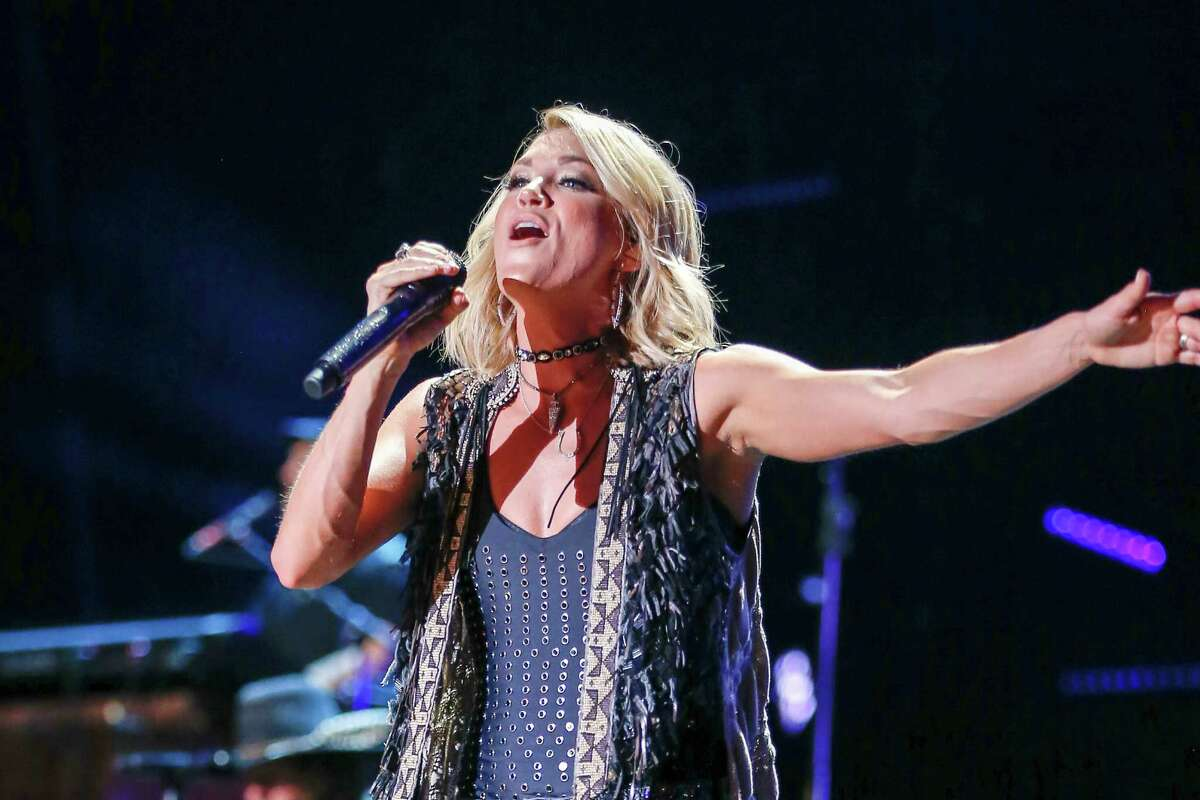 FILE - In a Friday, June 10, 2016 file photo, Carrie Underwood performs at the CMA Music Festival at Nissan Stadium, in Nashville, Tenn. (Photo by Al Wagner/Invision/AP, File)