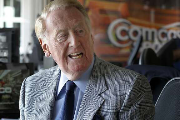 Vin Scully smiles at a comment by a a colleague before play Sunday September 14, 2014 at AT&T park. Hall of Fame Los Angeles Dodgers announcer Vin Scully was at AT&T park for the last Giants series and after six decades is still in his prime.