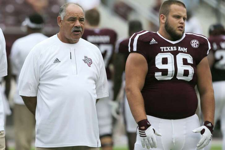 Texas A&M defensive coordinator John Chavis stands with defensive lineman Jesse Brown before kickoff against Prairie View on Sept. 10, 2016, in College Station.