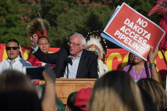"US Senator Bernie Sanders (C) speaks during a rally in front of the White House in Washington, DC, September 13, 2016, as demonstrators gathered to protest the Dakota Access Pipeline. The US government on September 9, 2016 sought to stop work on a controversial oil pipeline in North Dakota that has angered Native Americans, blocking any work on federal land and asking the company to ""voluntarily pause"" work nearby. / AFP PHOTO / JIM WATSONJIM WATSON/AFP/Getty Images"