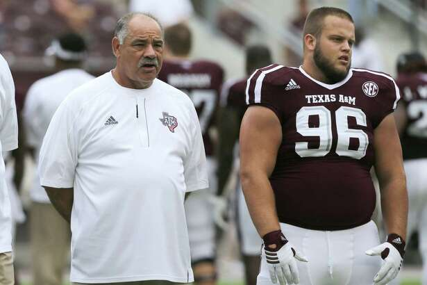 Offensive mastermind and Auburn coach Gus Malzahn, left, has been matching wits with defensive whiz John Chavis for years in the SEC as Chavis has served as coordinator at LSU and now A&M.