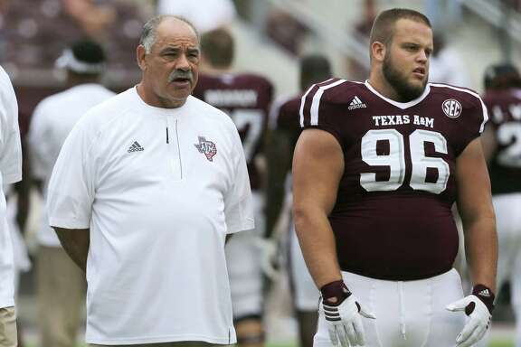 Texas A&M defensive coordinator John Chavis, left, stands with Texas A&M defensive lineman Jesse Brown (96) before the start of an NCAA college football game against Prairie View A&M Saturday, Sept. 10, 2016, in College Station, Texas. Texas A&M won 67-0.(AP Photo/Sam Craft)