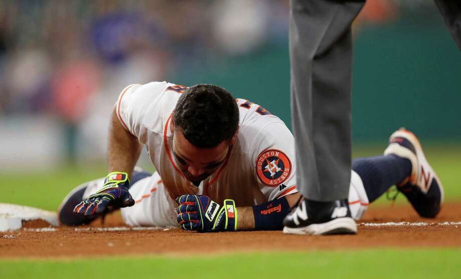 Houston Astros Jose Altuve (27) reacts after he was tagged out at first base following a single during the sixth inning of an MLB game at Minute Maid Park, Tuesday, Sept. 13, 2016 in Houston. Photo: Karen Warren, Houston Chronicle / 2016 Houston Chronicle