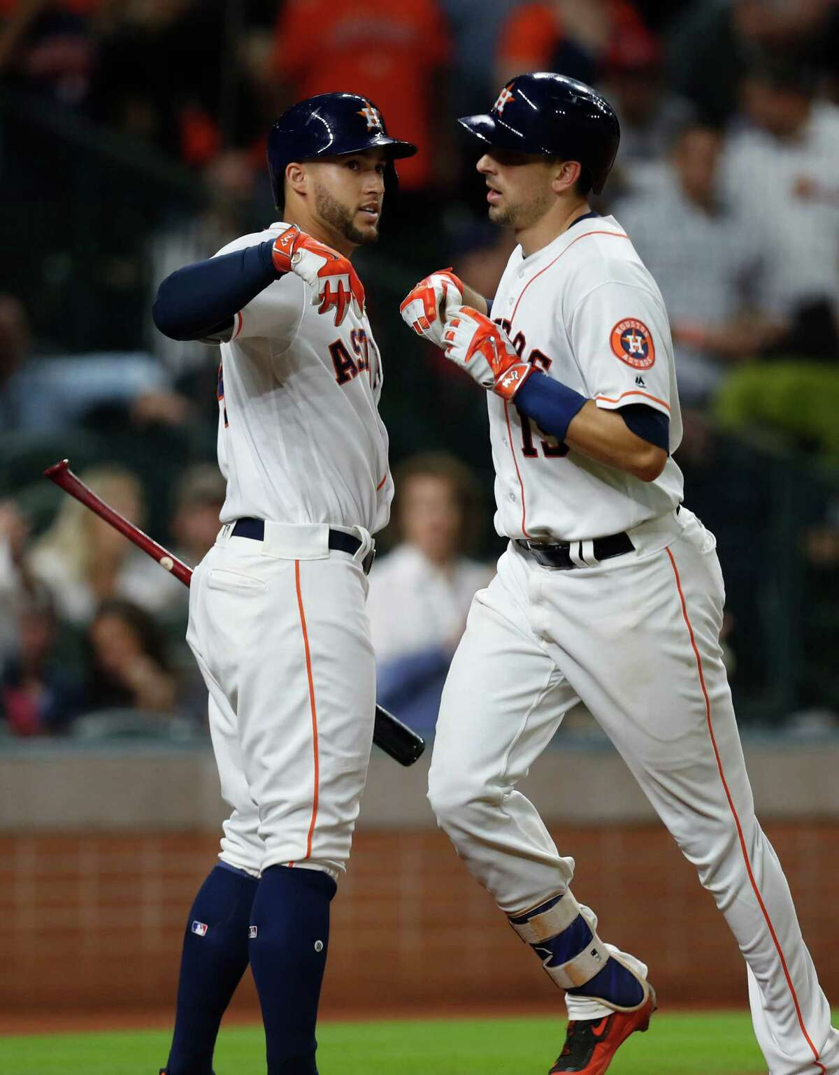 Houston Astros Jason Castro (15) celebrates his home run with George Springer (4) during the sixth inning of an MLB game at Minute Maid Park, Tuesday, Sept. 13, 2016 in Houston.