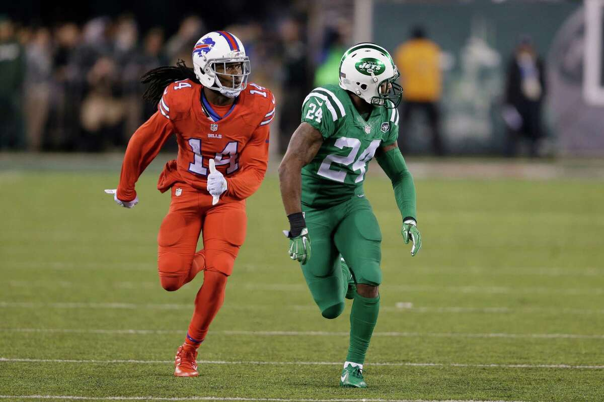 """FILE - In this Nov. 12, 2015, file photo, Buffalo Bills wide receiver Sammy Watkins, left, is defended by New York Jets cornerback Darrelle Revis during the first half of an NFL football game, in East Rutherford, N.J. The NFL isn't colorblind to the concerns of its TV audience regarding the """"Color Rush"""" alternate uniforms the Bills and Jets will wear Thursday night, Sept. 14, 2016. That's a switch from last year, when Buffalo wore all red and the Jets all green during their prime-time game on Nov. 12. The combinations led to colorblind viewers complaining they couldn't determine which team was which. (AP Photo/Seth Wenig, File) ORG XMIT: NY163"""