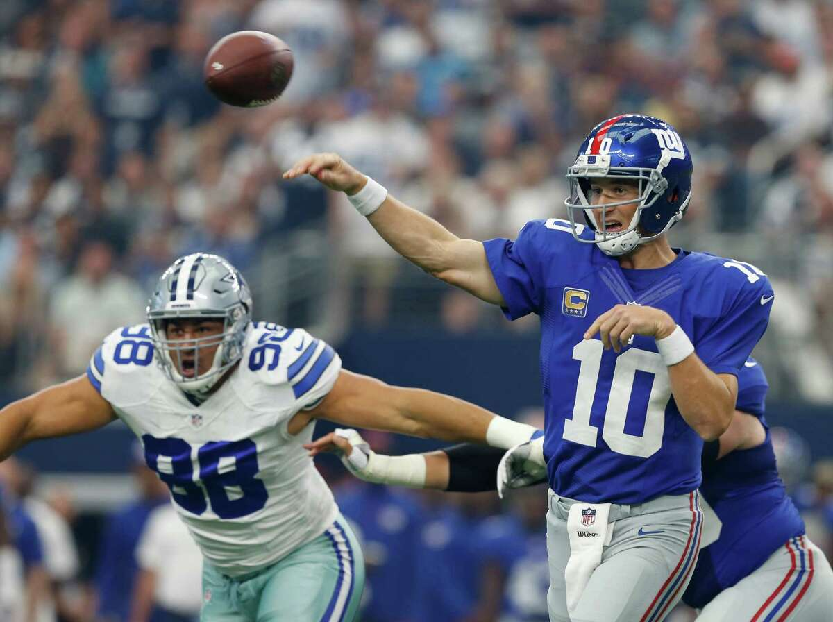New York Giant quarterback Eli Manning throws down field as Dallas Cowboy's Tyrone Crawford defends during the first half of an NFL football game at AT&T Stadium, Sunday, Sept. 11, 2016, in Arlington, Texas. (Jose Yau/Waco Tribune Herald via AP) ORG XMIT: TXWAC101