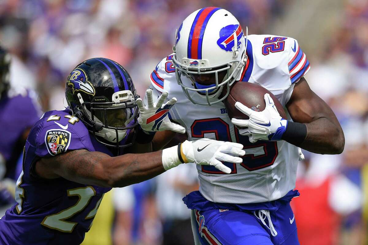 Buffalo Bills running back LeSean McCoy (25) is stopped by Baltimore Ravens cornerback Kyle Arrington (24) during the first half of an NFL football game in Baltimore, Sunday, Sept. 11, 2016. (AP Photo/Nick Wass) ORG XMIT: BAF105