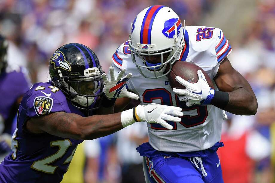 Buffalo Bills running back LeSean McCoy (25) is stopped by Baltimore Ravens cornerback Kyle Arrington (24) during the first half of an NFL football game in Baltimore, Sunday, Sept. 11, 2016. (AP Photo/Nick Wass) ORG XMIT: BAF105 Photo: Nick Wass / FR67404 AP