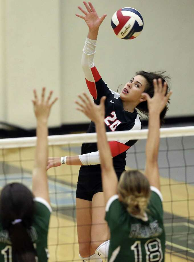 Churchill's Hannah Lopez goes high for a kill against Reagan at Littleton Gym on Sept. 13, 2016. Photo: Tom Reel /San Antonio Express-News / 2016 SAN ANTONIO EXPRESS-NEWS