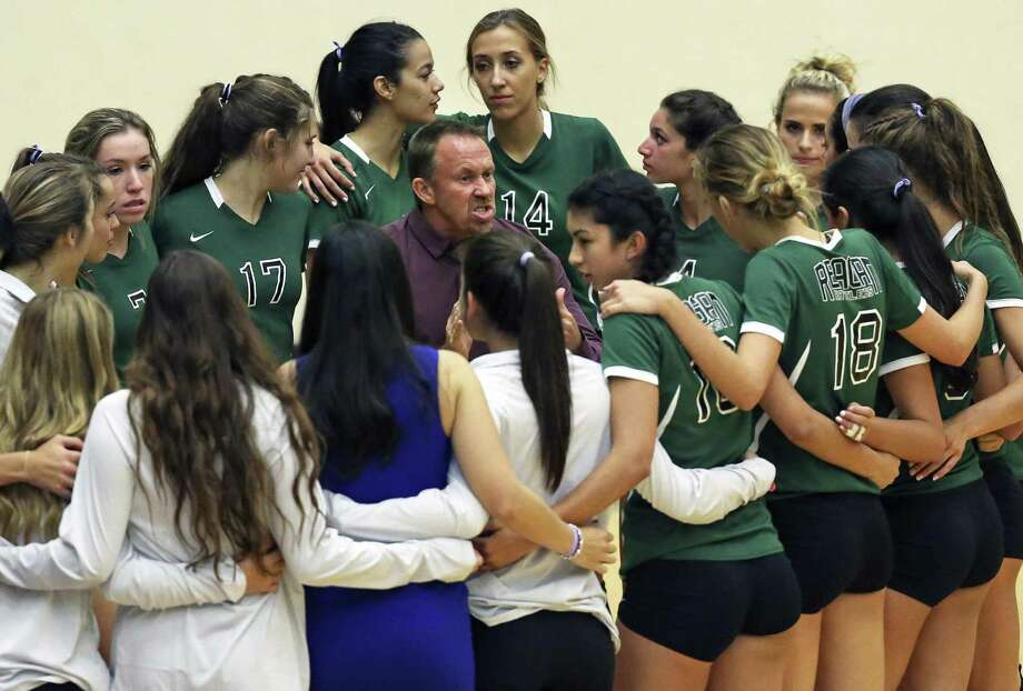 Rattler coach Mike Carter emphasizes in the huddle as Reagan plays Churchill in volleyball at Littleton Gym on September 13, 2016. Photo: TOM REEL, STAFF / SAN ANTONIO EXPRESS-NEWS / 2016 SAN ANTONIO EXPRESS-NEWS