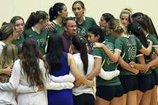 Reagan coach Mike Carter huddles with his team during a match against Churchill at Littleton Gym on Sept. 13, 2016.