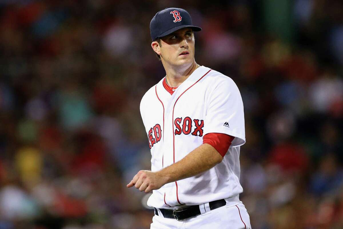 BOSTON, MA - AUGUST 30: Drew Pomeranz #31 of the Boston Red Sox returns to the dugout after being relieved during the seventh inning against the Tampa Bay Rays at Fenway Park on August 30, 2016 in Boston, Massachusetts. (Photo by Maddie Meyer/Getty Images) ORG XMIT: 607684297