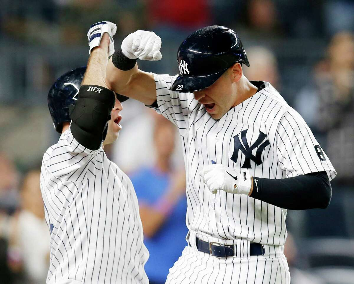 New York Yankees' Brett Gardner, left, celebrates with pinch-hitter Jacoby Ellsbury after Ellsbury' seventh-inning solo home run in New York, Tuesday, Sept. 13, 2016. (AP Photo/Kathy Willens) ORG XMIT: NYY115