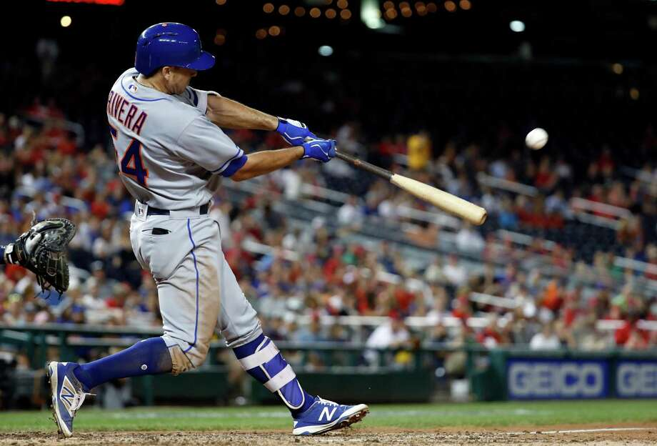 New York Mets' T.J. Rivera hits the game-wining solo home run during the 10th inning of a baseball game against the Washington Nationals at Nationals Park, Tuesday, Sept. 13, 2016, in Washington. Mets won 4-3 in 10 innings. (AP Photo/Alex Brandon) ORG XMIT: NAT114 Photo: Alex Brandon / Copyright 2016 The Associated Press. All rights reserved.