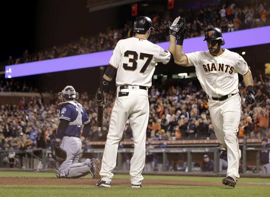San Francisco Giants' Angel Pagan, right, gets a high-five from Kelby Tomlinson after Pagan's solo home run against the San Diego Padres during the fifth inning of a baseball game Tuesday, Sept. 13, 2016, in San Francisco. (AP Photo/Marcio Jose Sanchez) Photo: Marcio Jose Sanchez, Associated Press