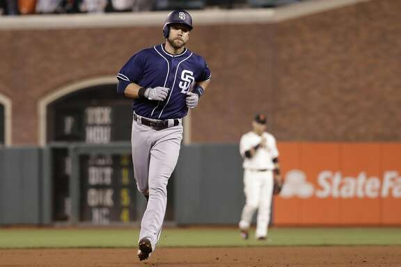 San Diego Padres' Ryan Schimpf rounds the bases after his three-run home run against the San Francisco Giants during the ninth inning of a baseball game Tuesday, Sept. 13, 2016, in San Francisco. San Diego won 6-4. (AP Photo/Marcio Jose Sanchez)