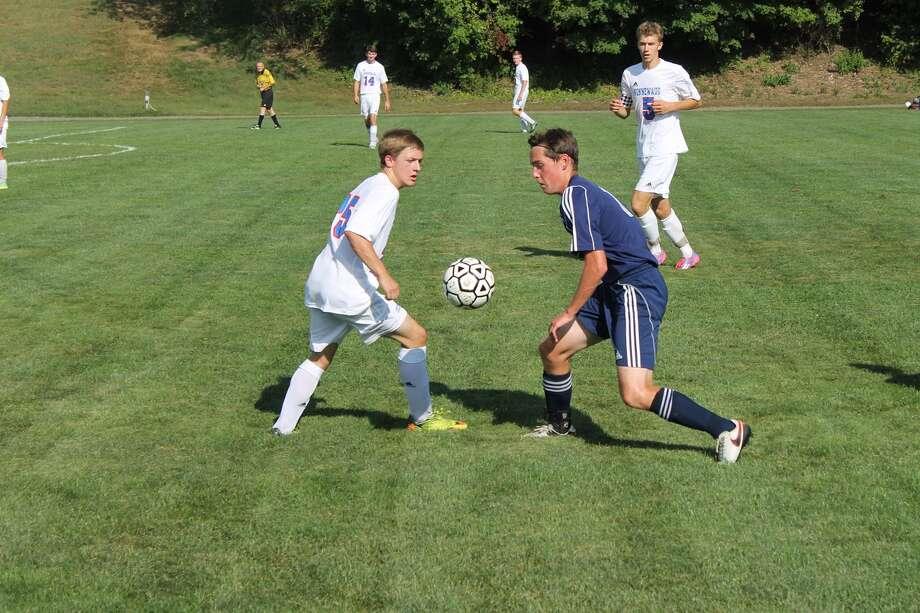 Shepaug's Eammon Crossley moves the ball in a game against Nonnewaug Sept. 9. Photo: John Nestor /The Spectrum
