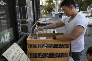 Kuang Chang looks through a crate of records on display outside Armadillo Records in Davis, CA Thursday, September 8, 2016.