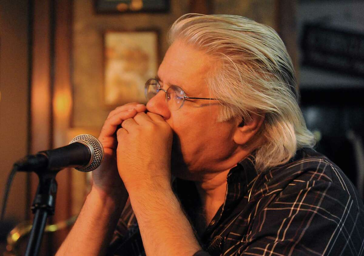 Greg Haymes plays a harmonica with The Ramblin Jug Stompers at McGeary's on Monday, June 20, 2016 in Albany, N.Y. (Lori Van Buren / Times Union)