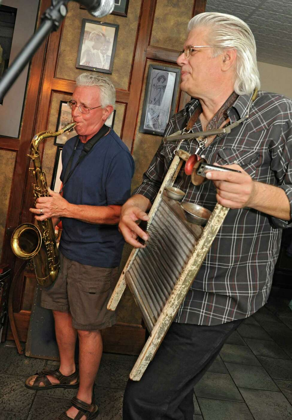 Josh Greenberg plays the saxophone as Greg Haymes plays the washboard with The Ramblin Jug Stompers at McGeary's on Monday, June 20, 2016 in Albany, N.Y. (Lori Van Buren / Times Union)