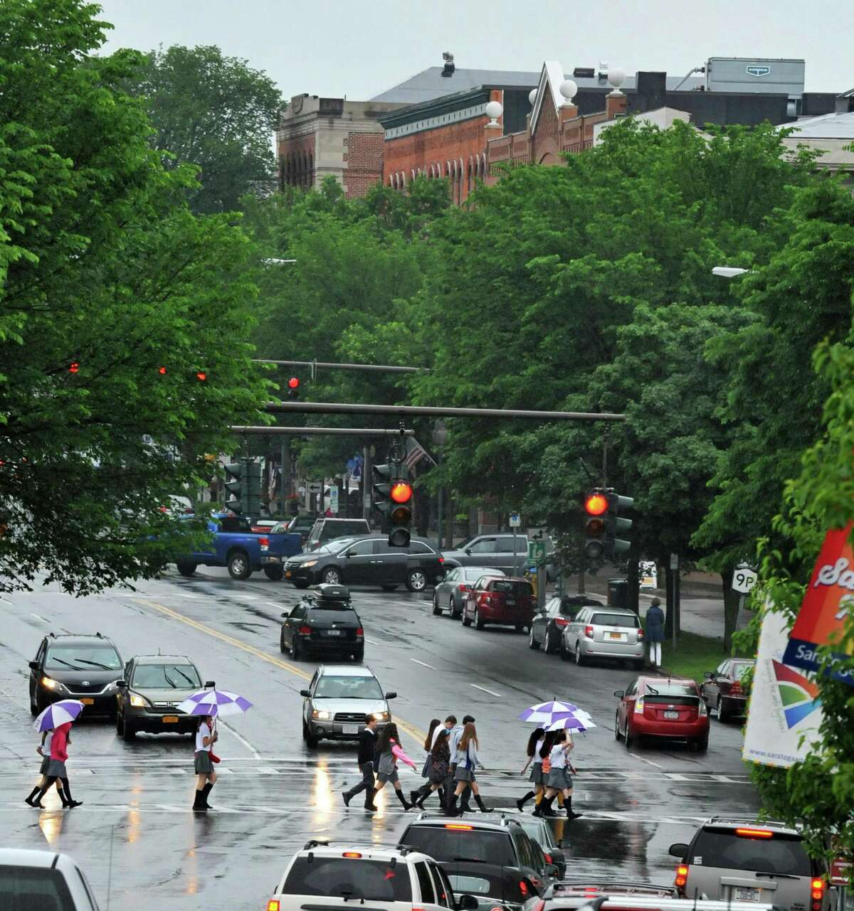 Pedestrians cross Broadway Thursday morning June 12, 2014, in Saratoga Springs, NY. (John Carl D'Annibale / Times Union)