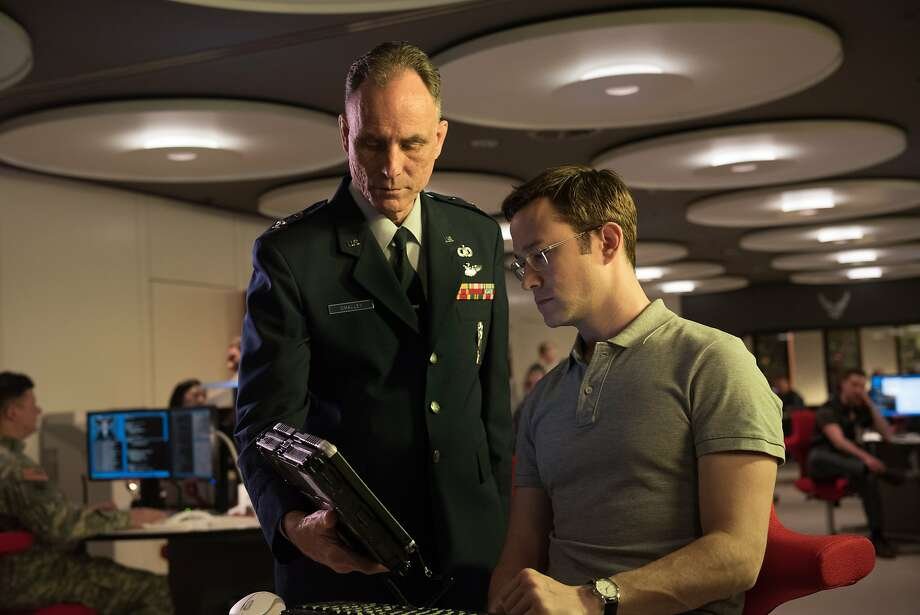 "Joseph Gordon-Levitt (right) in a scene from ""Snowden."" Photo: Jürgen Olczyk, Associated Press"