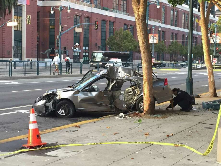 Police arrested three carjacking suspects after a chase through San Francisco early Wednesday ended in a crash near AT&T Park. Photo: Evan Sernoffsky / The Chronicle / /