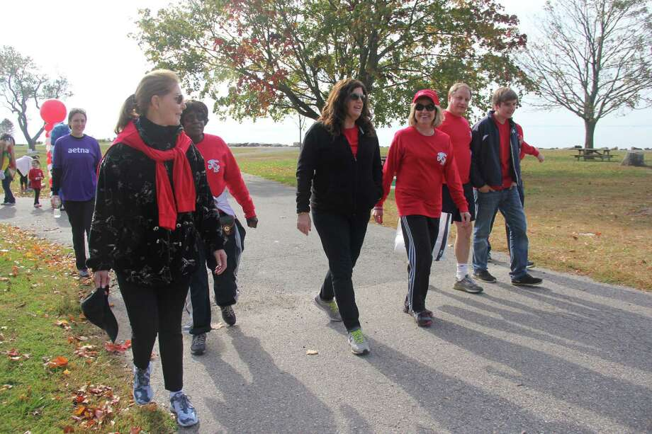 Former Ice Capades skater Karen Christensen of Wilton (third from right in hat) walked in the 2013 Heart Walk for the American Heart Association. This year's event will take place on Oct. 8 at Sherwood Island State Park in Westport. Photo: / Contributed Photo / Contributed photo