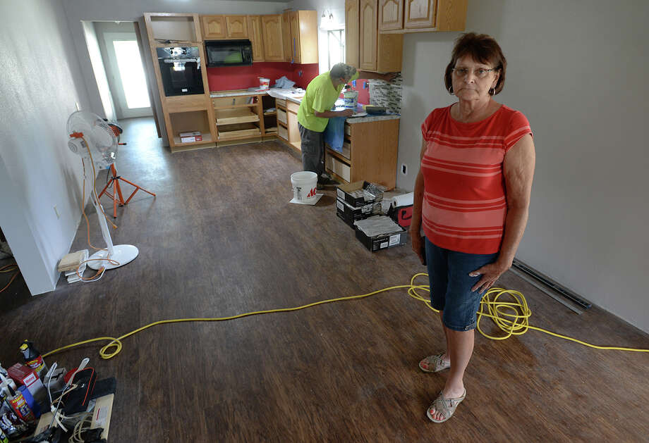 About six months after the Deweyville flooding, Lucille Salter stands in her kitchen while Vernon Buxton installs tile. Salter said she hopes to be moving back into her home this weekend. Photo taken Tuesday, September 13, 2016 Guiseppe Barranco/The Enterprise Photo: Guiseppe Barranco, Photo Editor
