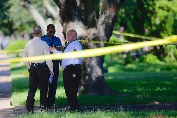 Detectives investigate the scene of a double shooting at a home on Red Rock Canyon Drive in Katy, Wednesday morning, September 14, 2016. (Mark Mulligan / Houston Chronicle)
