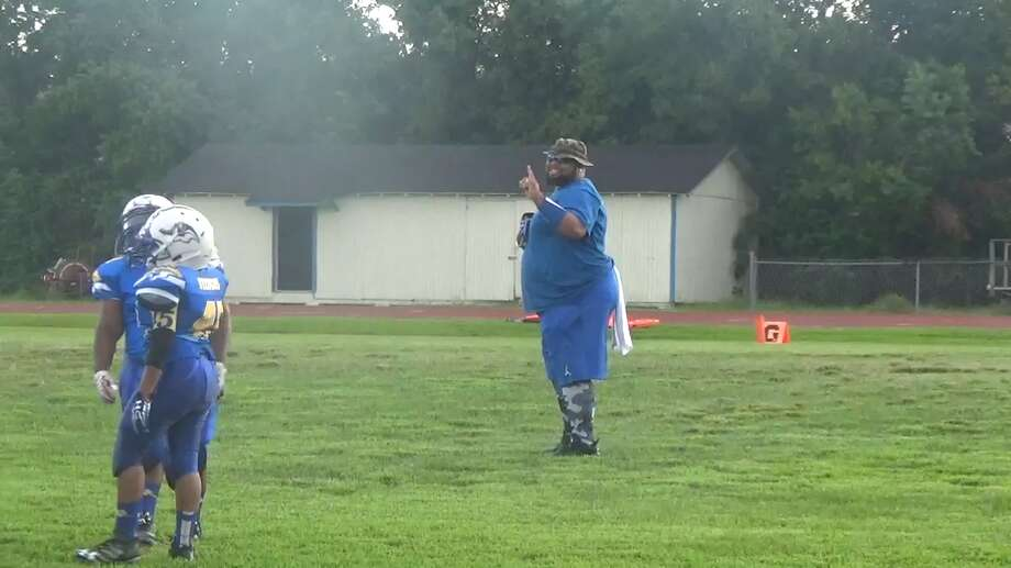 "A video of Beaumont youth football coach Jermaine Cooper, 34, dancing on the sideline has gone viral across the nation. Cooper, who has been a coach with the team for two years, is considered the ""hype man"" of the team. Photo: Joi Hill"