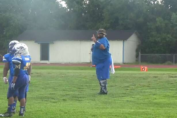 """A video of Beaumont youth football coach Jermaine Cooper, 34, dancing on the sideline has gone viral across the nation. Cooper, who has been a coach with the team for two years, is considered the """"hype man"""" of the team."""