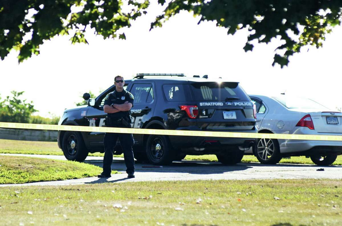 Officers from Stratford Police and the State Police investigate the scene of an officer-involved shooting in the Lordship section of Stratford on Wednesday.
