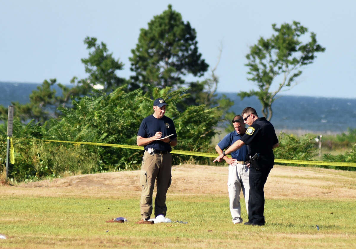 Officers from Stratford Police and the State Police investigate the scene of an officer-involved shooting in the Lordship section of Stratford, Conn. on Wednesday, Sept. 14, 2016. The man wounded fired at least one shot at officers, according to State Police.