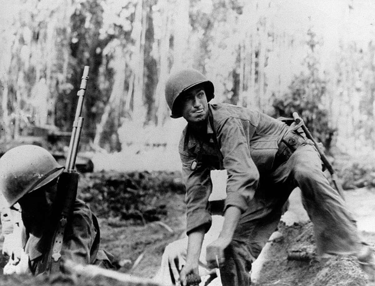 """Forrest E. Everhart - World War II Place and date: Near Kerling, France, 12 November 1944 Actions: """"With the 1 remaining gunner, he directed furious fire into the advancing hordes until they swarmed close to the position. He left the gun, boldly charged the attackers and, after a 15-minute exchange of hand grenades, forced them to withdraw leaving 30 dead behind. He re-crossed the fire-swept terrain to his then threatened right flank, exhorted his men and directed murderous fire from the single machinegun at that position. There, in the light of bursting mortar shells, he again closed with the enemy in a hand grenade duel and, after a fierce 30-minute battle, forced the Germans to withdraw leaving another 20 dead."""""""