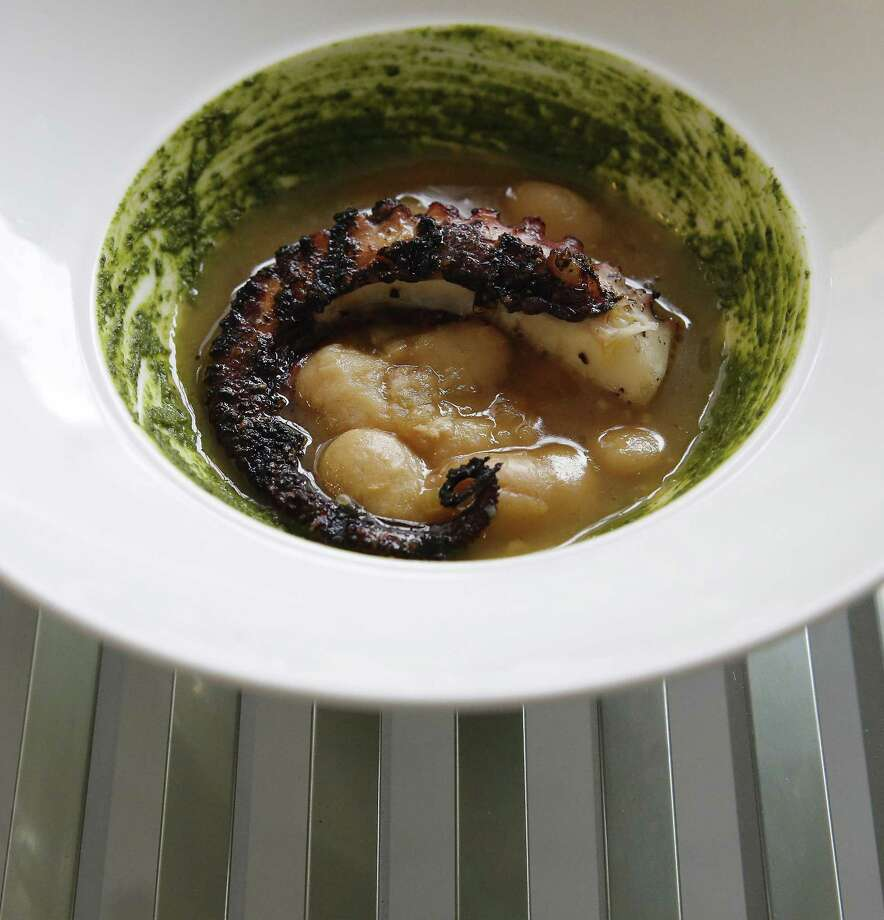 Char-grilled Spanish Octopus with braised corona beans and a basil pistou at Rebelle Photo: Kin Man Hui /San Antonio Express-News / ©2016 San Antonio Express-News