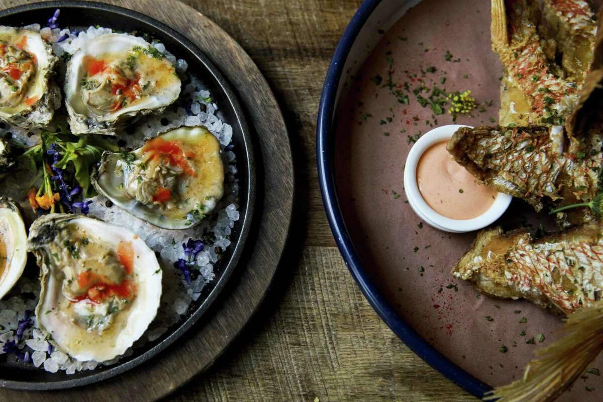 Wood-broiled oysters and snapper throats are specialties at Southerleigh Fine Food & Brewery at The Pearl.
