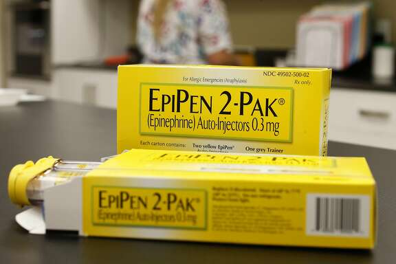 Mylan NV EpiPen 2-Pak medication sits on a table inside a pharmacy in Provo, Utah, U.S., on Wednesday, Aug. 31, 2016. A Nov. 2015 forecast from health data firm IMS Health expects global sales of brand and generic prescription drugs, and nonprescription medicines, to total $1.4 trillion in 2020. Photographer: George Frey/Bloomberg