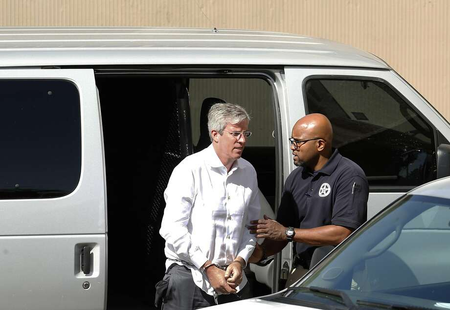 Tim Duncan's former financial adviser, Charles Banks, upon turning himself in on federal charges on Friday, September 9, 2016. Photo: Ron Cortes