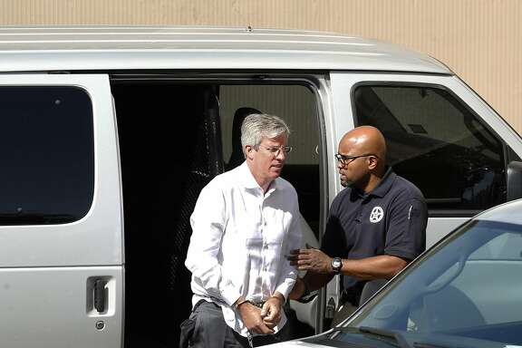 Tim Duncan's former financial adviser, Charles Banks, is transported to federal court early Friday morning after he turned himself in on federal charges. Banks was apparently indicted this week in connection with allegations that he duped Duncan into making certain investments, losing between $1.1 million and $25 million of Duncan's money. Photos taken on Friday, September 9, 2016.