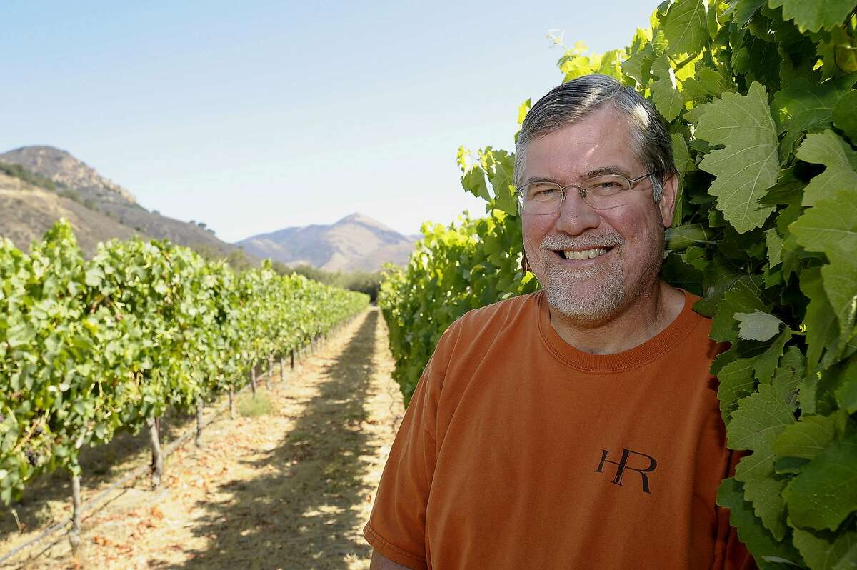 Winemaker, owner Bob Lindquist of Qupe wines poses for a photo next to his vineyards in Santa Maria, California on Friday, August 7, 2009. Photo/Phil Klein