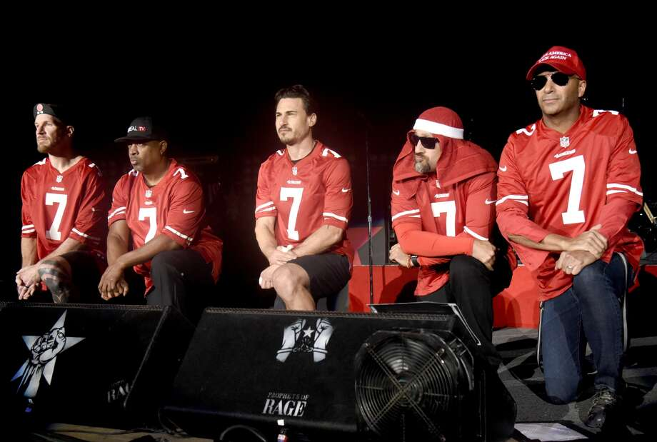 (Left to right) Tim Commerford, Chuck D, Brad Wilk, B Real, and Tom Morello of Prophets of Rage take a stand on violence at Shoreline Amphitheatre on September 14, 2016 in Mountain View, California.